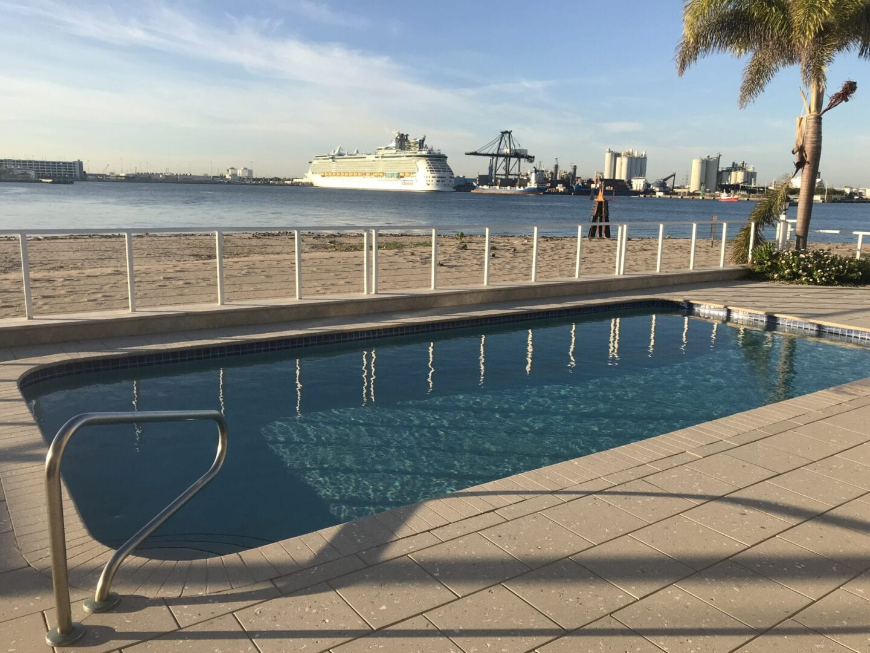 Rounded rectangle pool near the sea shore (sunny)