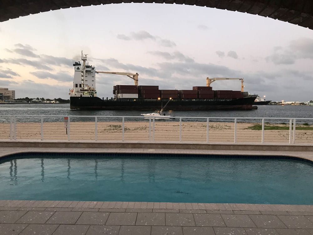A cargo ship passing nearby (viewed from a shelter in the pool area)