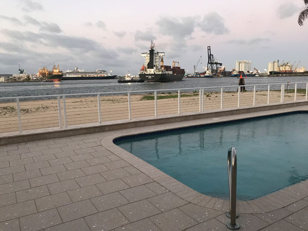 Rounded rectangle pool near the ocean with ships passing by (different angle)