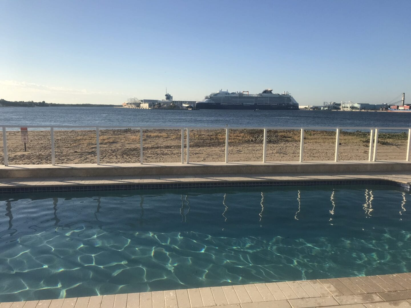 Pool near the ocean, enclosed by a fence