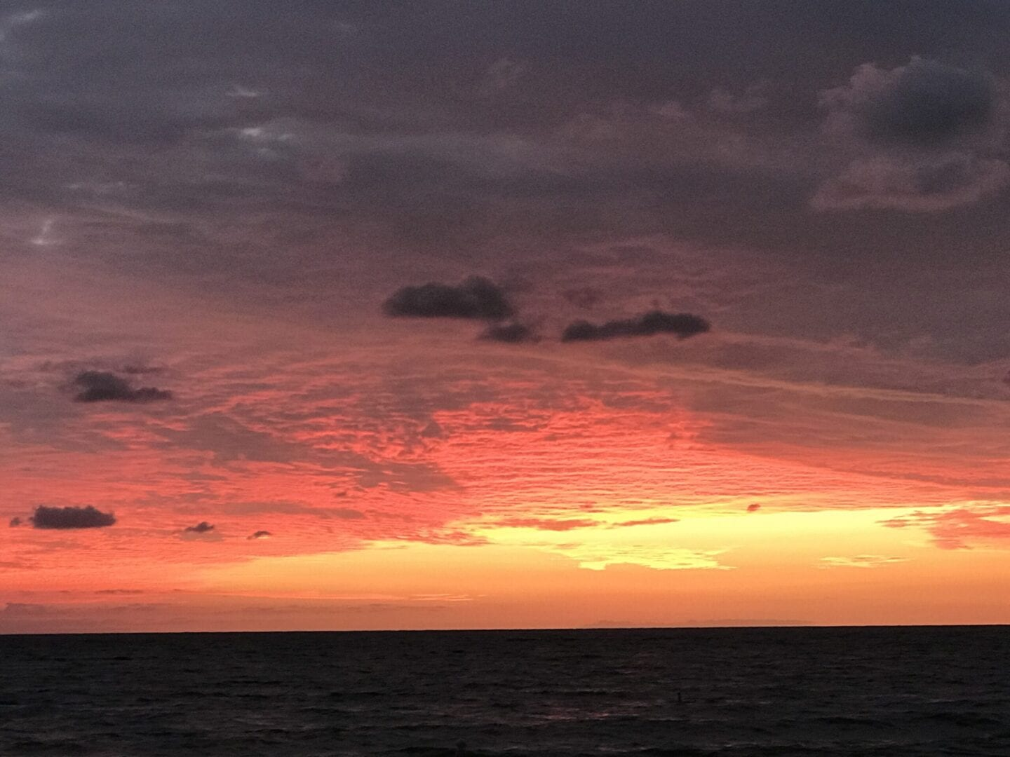 Orange and pink sunset skies in the sea