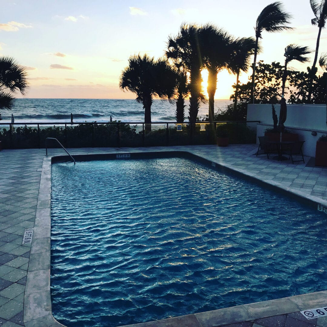 Rounded rectangle pool near the beach (windy sunset)