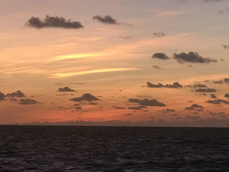 Purple and orange sunset skies at the beach