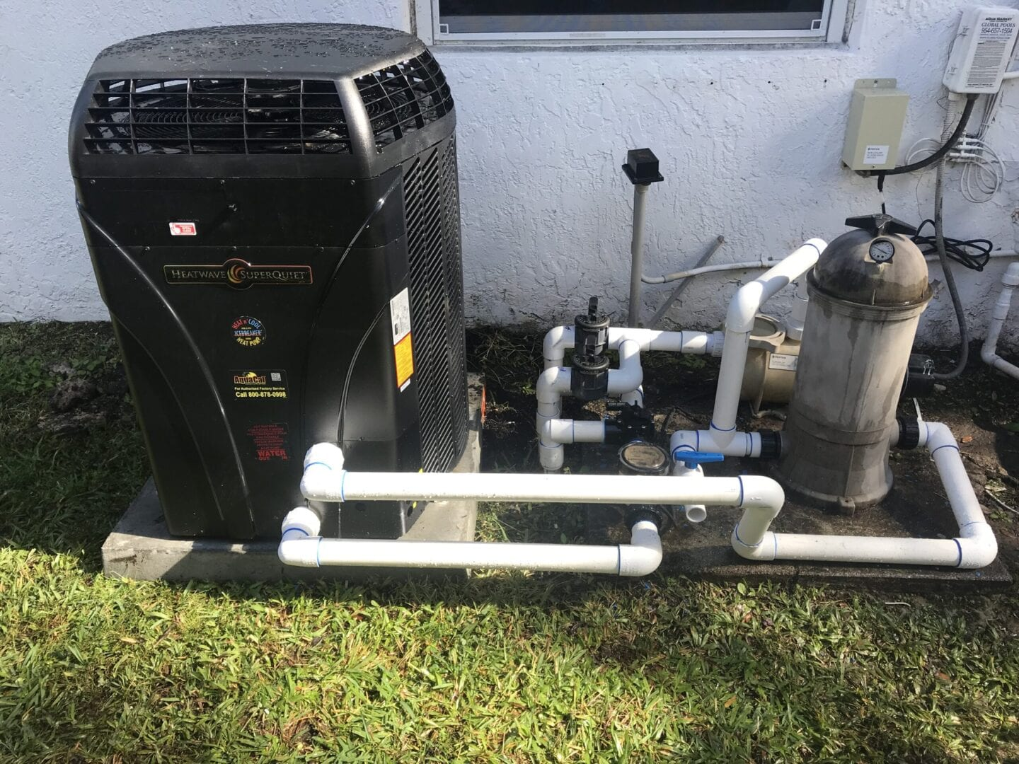 AquaCal heat pump with pipes