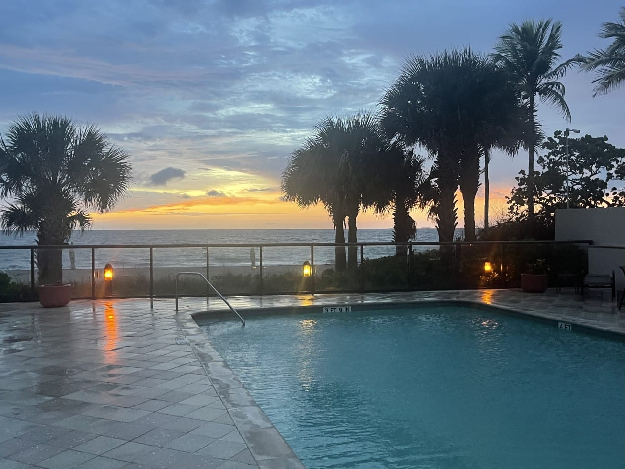 Rounded rectangle pool near the beach (sunset)